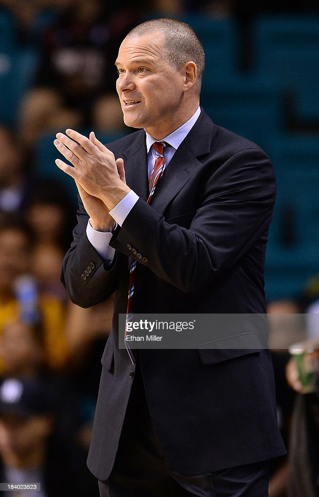 Head coach Michael Malone of the Sacramento Kings gestures to his players as they take on the Los Angeles Lakers during their preseason game at the MGM Grand Garden Arena on October 10, 2013 in Las Vegas, Nevada. Sacramento won 104-86.