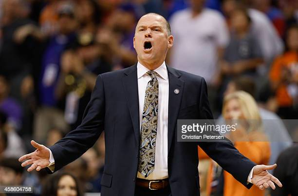 Head coach Michael Malone of the Sacramento Kings reacts during the NBA game against the Phoenix Suns at US Airways Center on November 7 2014 in...