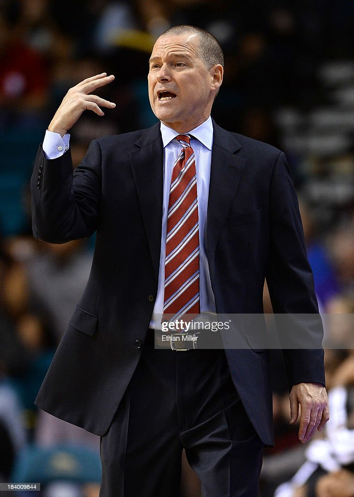 Head coach Michael Malone of the Sacramento Kings yells to his players as they take on the Los Angeles Lakers during their preseason game at the MGM Grand Garden Arena on October 10, 2013 in Las Vegas, Nevada. Sacramento won 104-86.