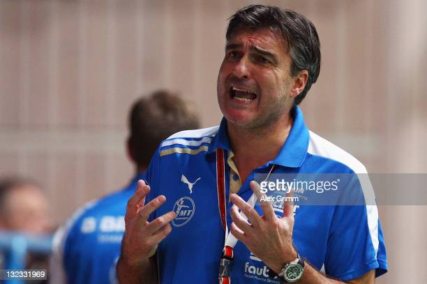 Head coach Michael Roth of Melsungen reacts during the Toyota Handball Bundesliga match between T VGrosswallstadt and MT Melsungen at fan...