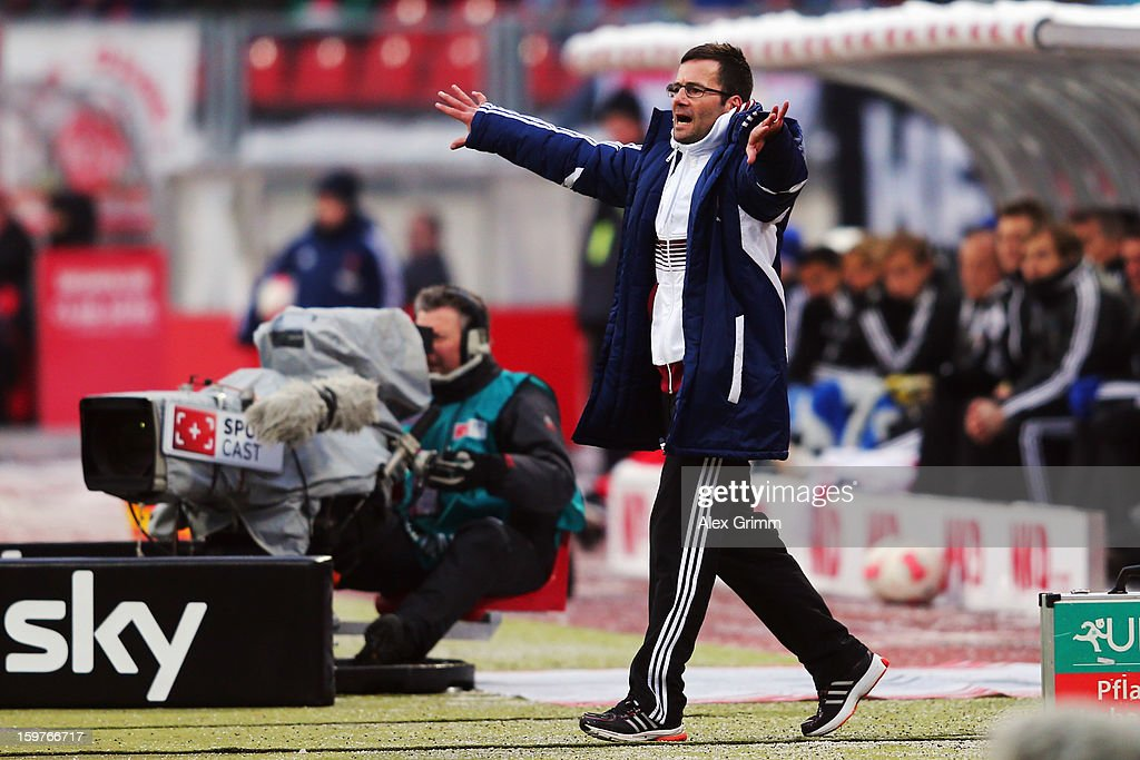 Head coach Michael Wiesinger of Nuernberg gestures during the Bundesliga match between 1. FC Nuernberg and Hamburger SV at Easy Credit Stadium on January 20, 2013 in Nuremberg, Germany.
