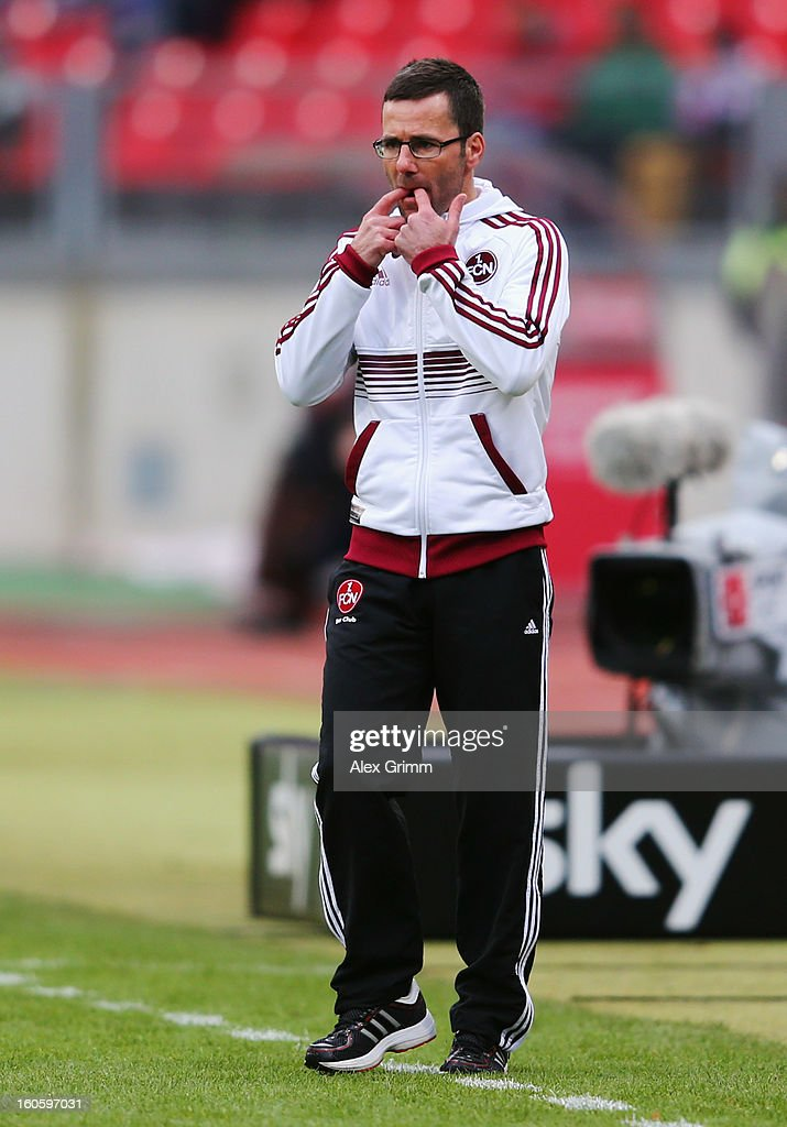 Head coach Michael Wiesinger of Nuernberg reacts during the Bundesliga match between 1. FC Nuernberg and VfL Borussia Moenchengladbach at Easy Credit Stadium on February 3, 2013 in Nuremberg, Germany.