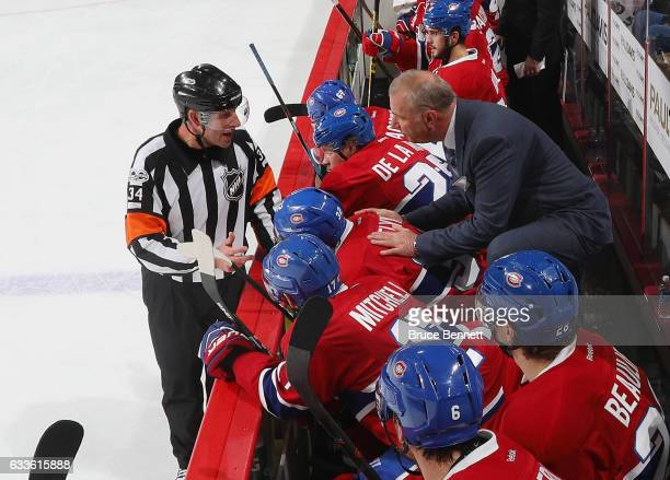 Head coach Michel Therrien of the Michel Therrien gets an explanation from referee Brad Meier during the game against the Philadelphia Flyers at the...