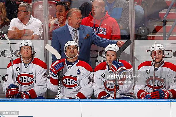 Head Coach Michel Therrien of the Montreal Canadiens directs his team from the bench against the Florida Panthers at the BBT Center on April 5 2015...