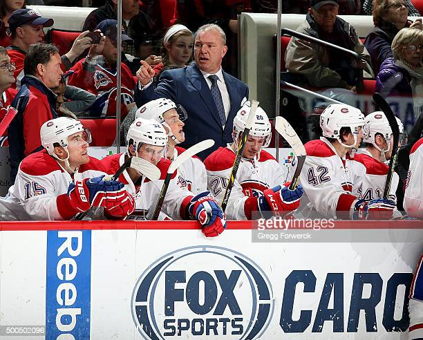 Head coach Michel Therrien of the Montreal Canadiens instructs his team during a NHL game against the Carolina Hurricanes at PNC Arena on December 5...