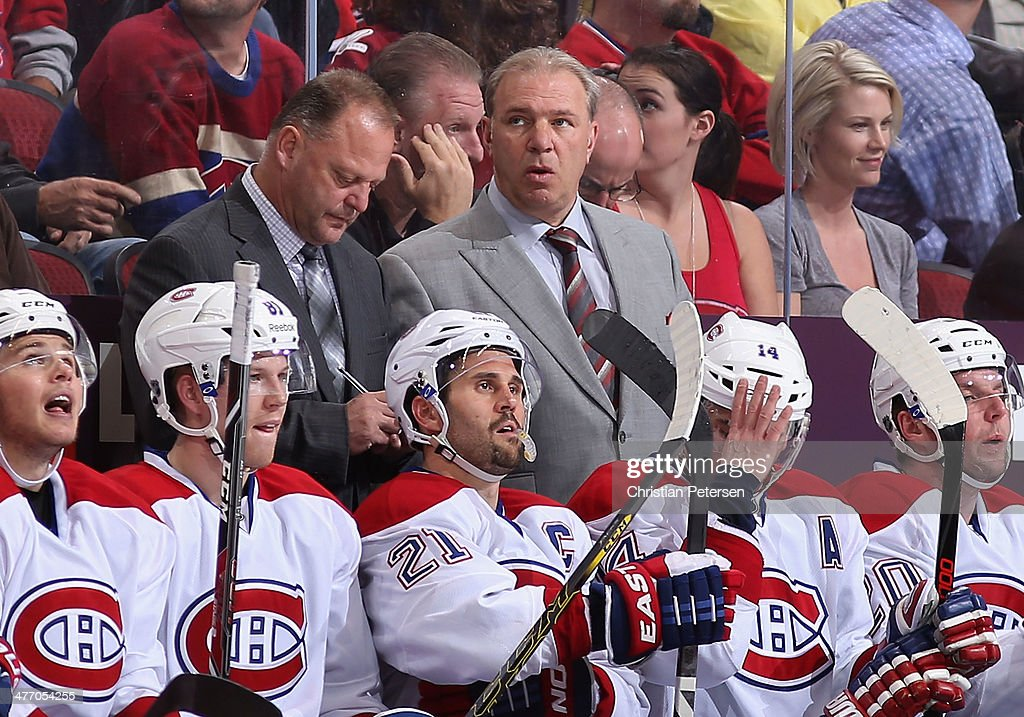 Head coach <a gi-track='captionPersonalityLinkClicked' href=/galleries/search?phrase=Michel+Therrien&family=editorial&specificpeople=241575 ng-click='$event.stopPropagation()'>Michel Therrien</a> of the Montreal Canadiens looks up from the bench during the NHL game against the Phoenix Coyotes at Jobing.com Arena on March 6, 2014 in Glendale, Arizona. The Coyotes defeated the Canadiens 5-2.