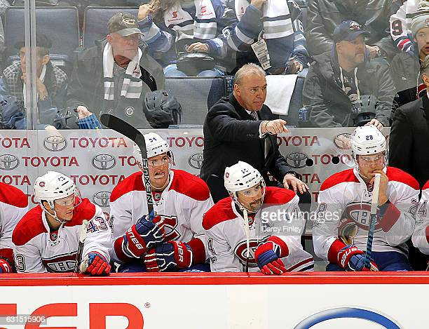 Head Coach Michel Therrien of the Montreal Canadiens points from the bench during second period action against the Winnipeg Jets at the MTS Centre on...