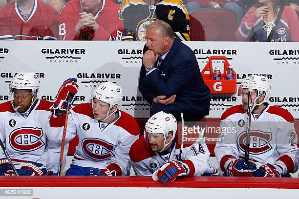 Head coach Michel Therrien of the Montreal Canadiens watches from the bench during the NHL game against the Arizona Coyotes at Gila River Arena on...