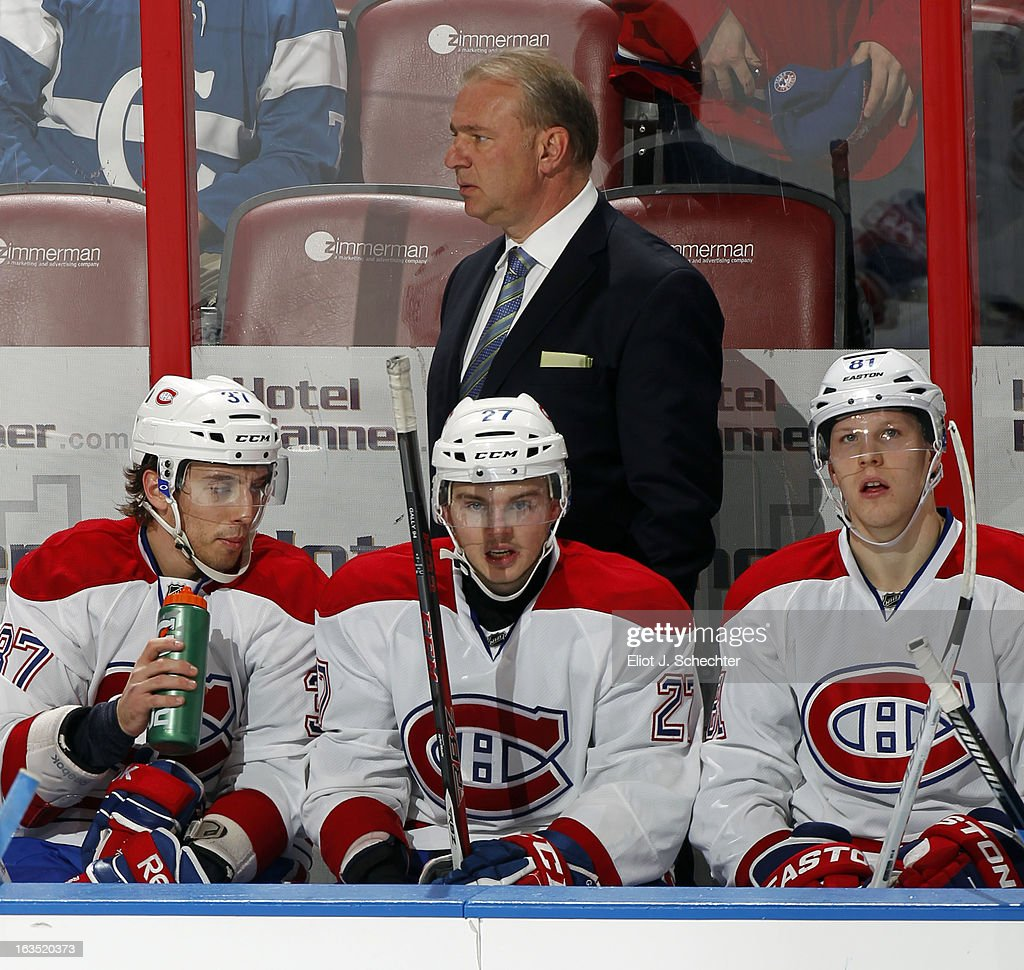 Head Coach Michel Therrien of the Montreal Canadiens watches the action from the bench against the Florida Panthers at the BB&T Center on March 10, 2013 in Sunrise, Florida.