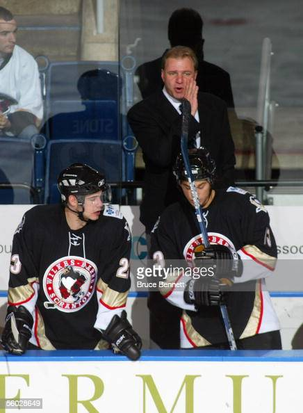 Head Coach Michel Therrien of the WilkesBarre/Scranton Penguins looks on from the bench during their game against the Bridgeport Sound Tigers at...