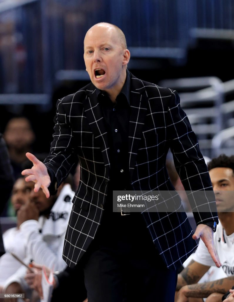 Head coach Mick Cronin of the Cincinnati Bearcats calls a play during a semifinal game of the 2018 AAC Basketball Championship against the Memphis Tigers at Amway Center on March 10, 2018 in Orlando, Florida.