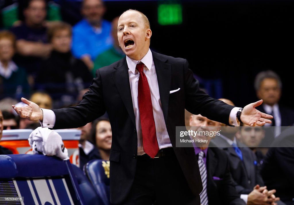 Head coach Mick Cronin of the Cincinnati Bearcats protests a call against the Notre Dame Fighting Irish] at Purcel Pavilion on February 24, 2013 in South Bend, Indiana. Notre Dame defeated Cincinnati 62-41.
