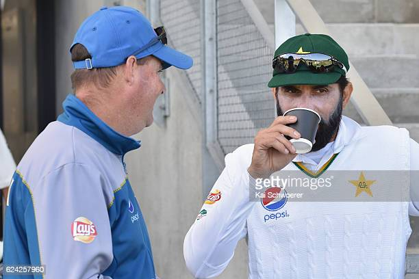 Head Coach Mickey Arthur and MisbahulHaq of Pakistan look on during day three of the First Test between New Zealand and Pakistan at Hagley Oval on...