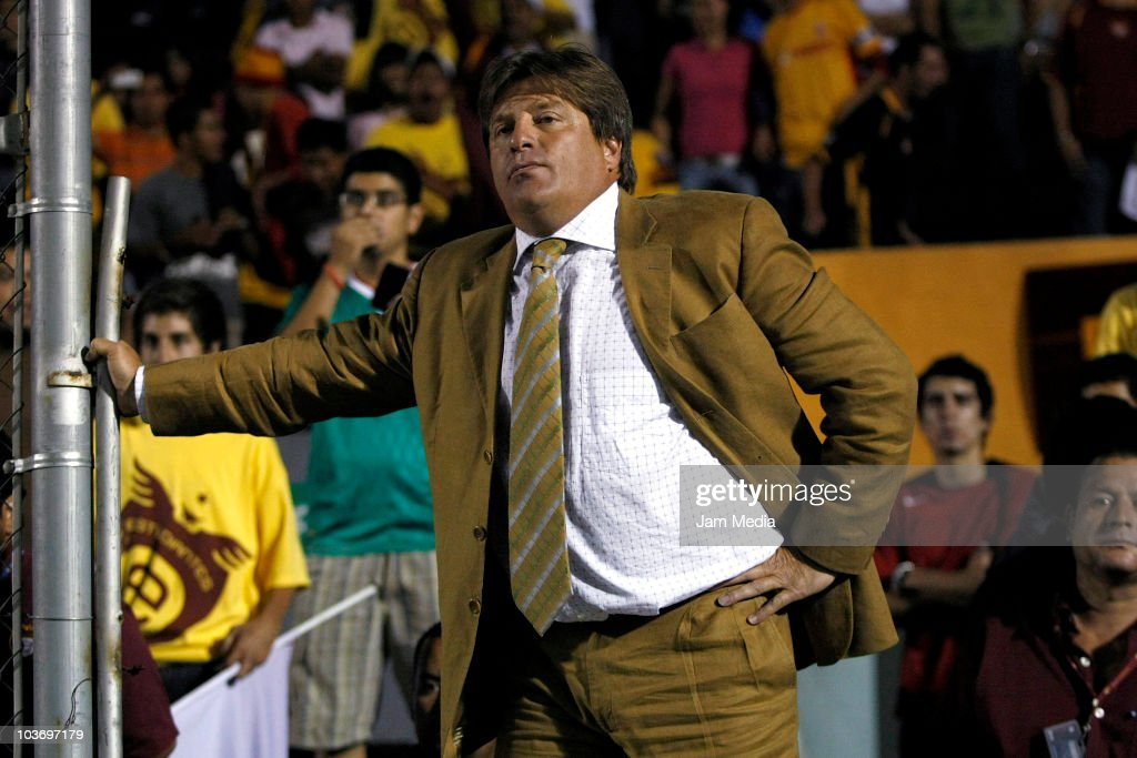 Head coach <a gi-track='captionPersonalityLinkClicked' href=/galleries/search?phrase=Miguel+Herrera+-+Entrenador+de+f%C3%BAtbol&family=editorial&specificpeople=12319687 ng-click='$event.stopPropagation()'>Miguel Herrera</a> of Estudiantes reacts during a match against Morelia as part of the Apertura 2010 at 3 de Marzo Stadium on August 27, 2010 in Guadalajara, Mexico.