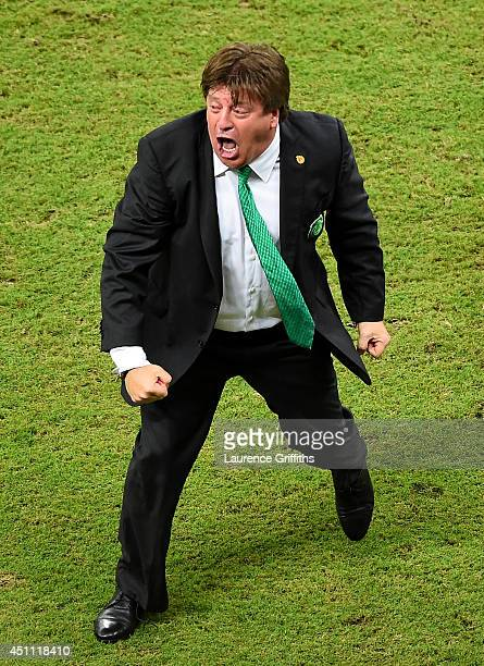 Head coach Miguel Herrera of Mexico celebrates after his team's first goal during the 2014 FIFA World Cup Brazil Group A match between Croatia and...