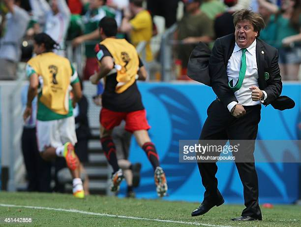 Head coach Miguel Herrera of Mexico celebrates his team's first goal during the 2014 FIFA World Cup Brazil Round of 16 match between Netherlands and...