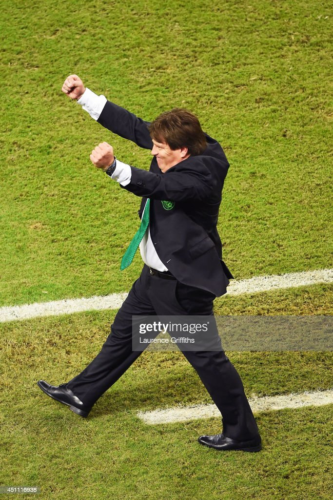 Head coach <a gi-track='captionPersonalityLinkClicked' href=/galleries/search?phrase=Miguel+Herrera+-+Entrenador+de+f%C3%BAtbol&family=editorial&specificpeople=12319687 ng-click='$event.stopPropagation()'>Miguel Herrera</a> of Mexico celebrates victory in the 2014 FIFA World Cup Brazil Group A match between Croatia and Mexico at Arena Pernambuco on June 23, 2014 in Recife, Brazil.