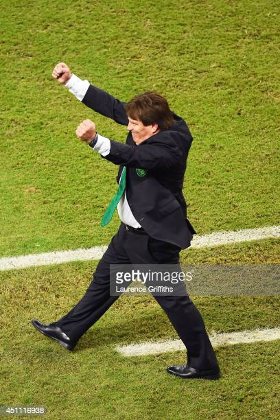 Head coach Miguel Herrera of Mexico celebrates victory in the 2014 FIFA World Cup Brazil Group A match between Croatia and Mexico at Arena Pernambuco...