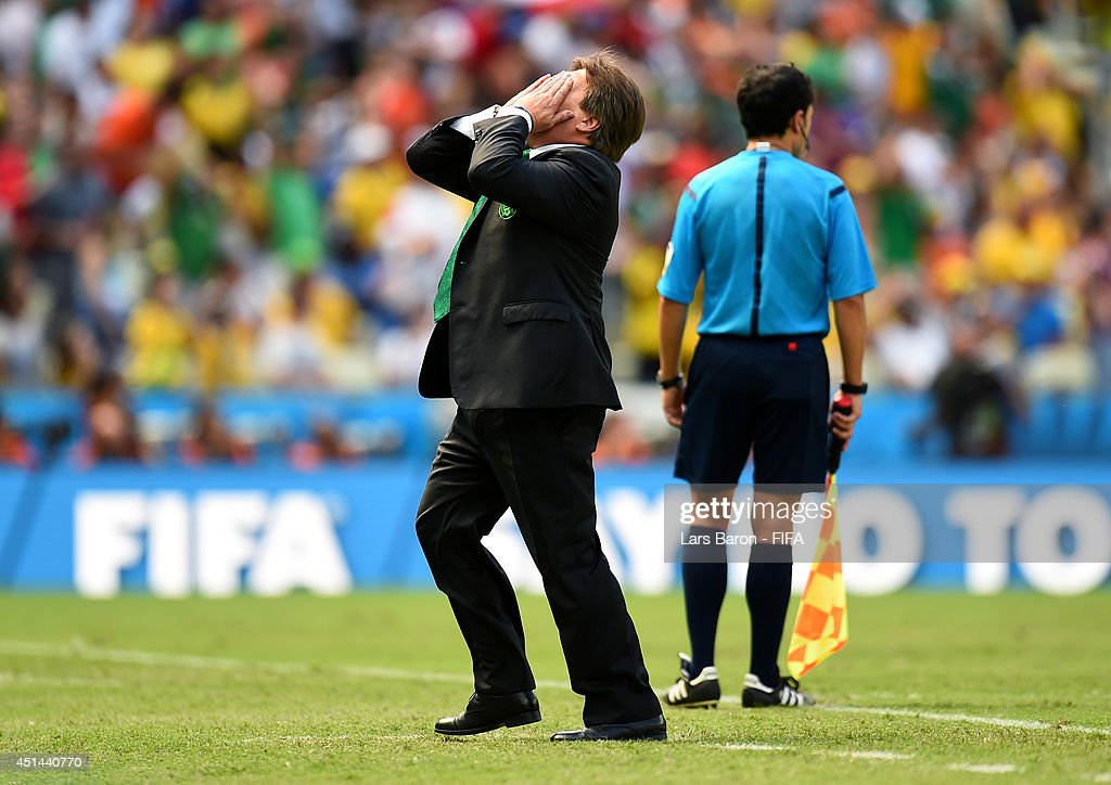 Head coach <a gi-track='captionPersonalityLinkClicked' href=/galleries/search?phrase=Miguel+Herrera+-+Soccer+Coach&family=editorial&specificpeople=12319687 ng-click='$event.stopPropagation()'>Miguel Herrera</a> of Mexico reacts during the 2014 FIFA World Cup Brazil Round of 16 match between Netherlands and Mexico at Estadio Castelao on June 29, 2014 in Fortaleza, Brazil.