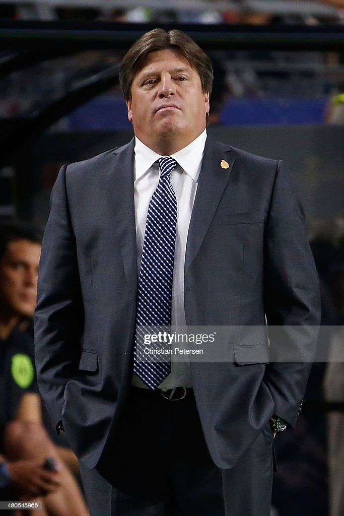 Head coach <a gi-track='captionPersonalityLinkClicked' href=/galleries/search?phrase=Miguel+Herrera+-+Entrenador+de+f%C3%BAtbol&family=editorial&specificpeople=12319687 ng-click='$event.stopPropagation()'>Miguel Herrera</a> of Mexico reacts on the sidelines during the 2015 CONCACAF Gold Cup group C match against Guatemala at University of Phoenix Stadium on July 12, 2015 in Glendale, Arizona. Guatemala and Mexico finished in a 0-0 tie.