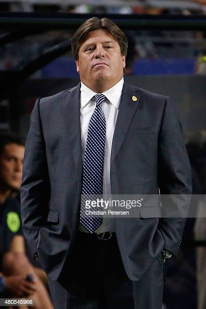 Head coach Miguel Herrera of Mexico reacts on the sidelines during the 2015 CONCACAF Gold Cup group C match against Guatemala at University of...