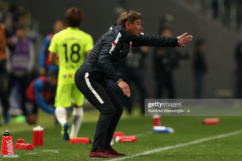 Head coach Mihailo Petrovic of Urawa Red Diamonds gives instruction to his players during the J.League J1 match between Gamba Osaka and Urawa Red Diamonds at Suita City Football Stadium on March 19, 2017 in Suita, Osaka, Japan.