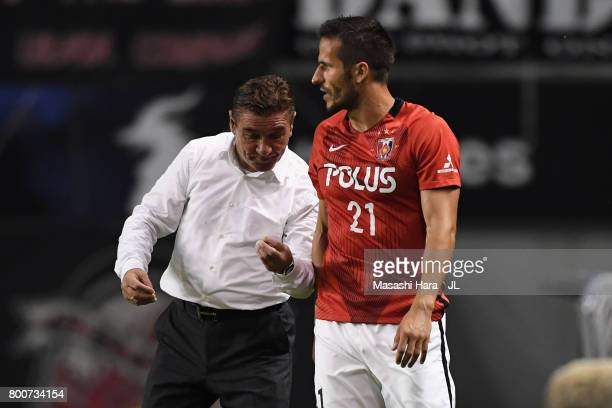 Head coach Mihailo Petrovic of Urawa Red Diamonds gives instruction to Zlatan Ljubijankic during the JLeague J1 match between Sagan Tosu and Urawa...