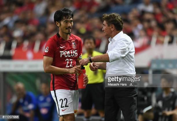 Head coach Mihailo Petrovic of Urawa Red Diamonds gives instruction to Yuki Abe during the JLeague J1 match between Urawa Red Diamonds and Albirex...