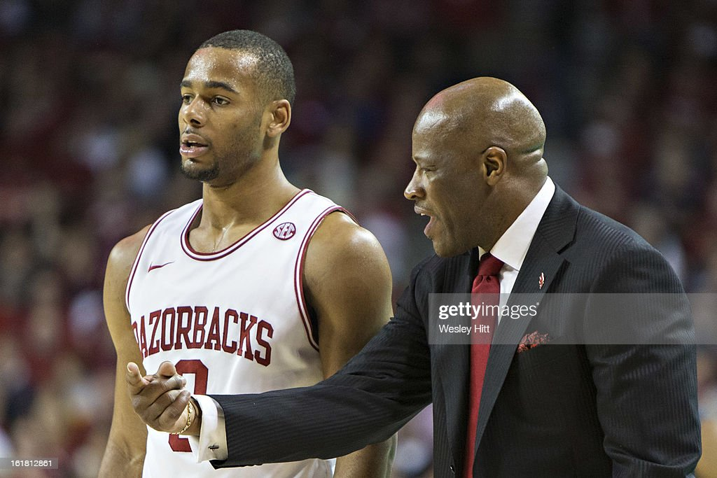 Head Coach Mike Anderson talks with Rickey Scott #3 of the Arkansas Razorbacks during a game against the Missouri Tigers at Bud Walton Arena on February 16, 2013 in Fayetteville, Arkansas. The Razorbacks defeated the Tigers 73-71.