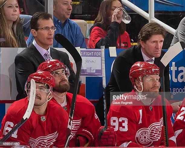 Head coach Mike Babcock and assistant coach Tony Granato of the Detroit Red Wings stand next to a 'Hockey Fights Cancer' sign dedicated to General...