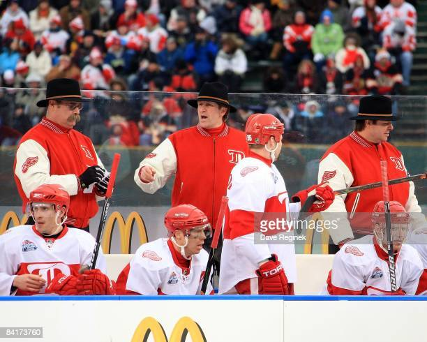 Head Coach Mike Babcock and assitant coaches Paul MacLean and Brad McCrimmon of the Detroit Red Wings stand behind the bench during a NHL game...