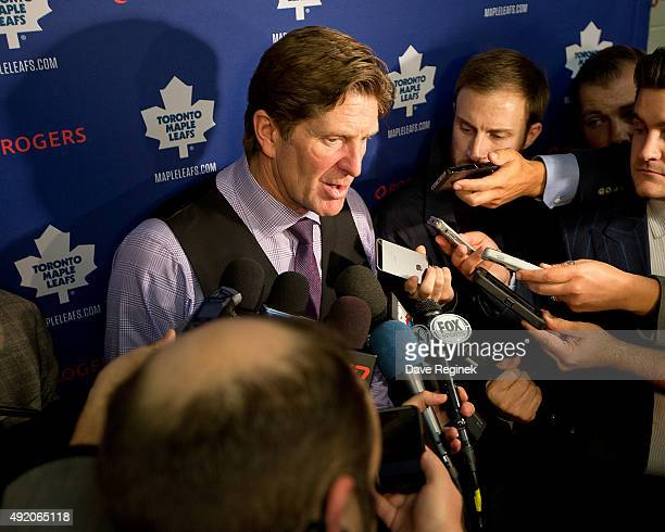 Head coach Mike Babcock answers questions from the media after an NHL game against the Detroit Red Wings at Joe Louis Arena on October 9 2015 in...