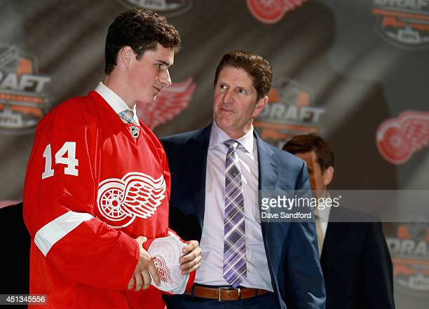 Head coach Mike Babcock congratulates Dylan Larkin after being selected 15th overall by the Detroit Red Wings during the 2014 NHL Entry Draft at...