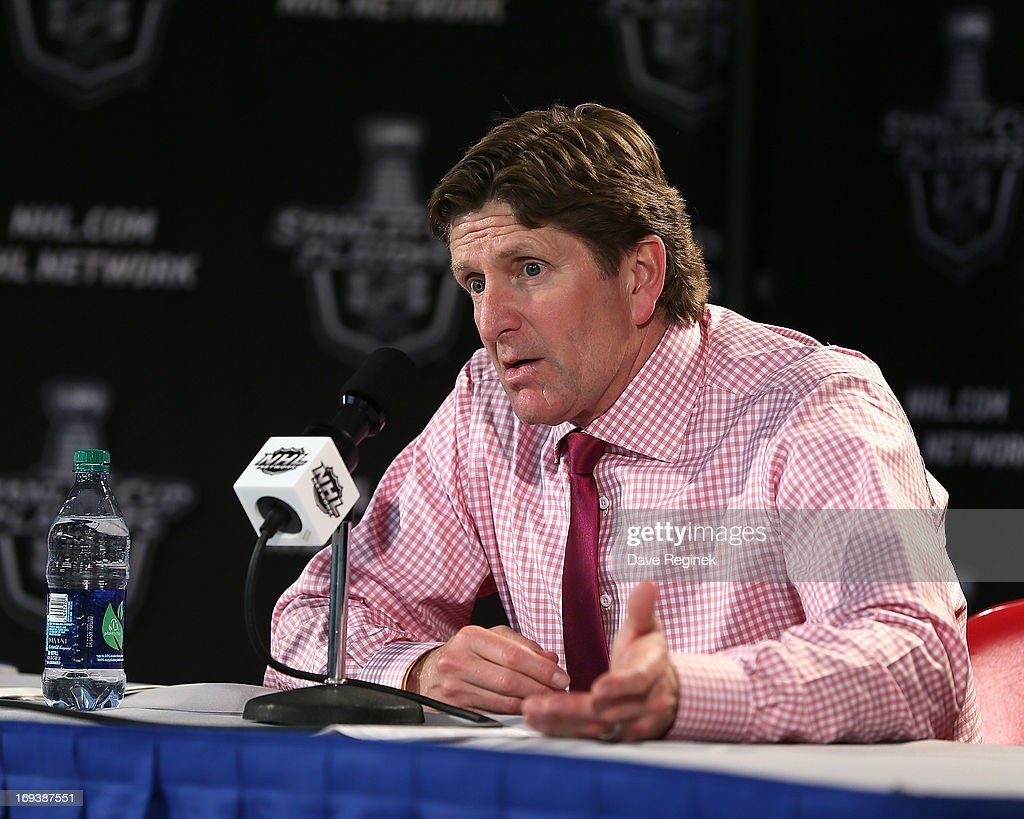 Head Coach Mike Babcock of the Detroit Red Wings addresses the media after Game Four of the Western Conference Semifinals against the Chicago Blackhawks during the 2013 NHL Stanley Cup Playoffs at Joe Louis Arena on May 23, 2013 in Detroit, Michigan. Detroit defeated Chicago 2-0 to take a 3-1 lead in the series