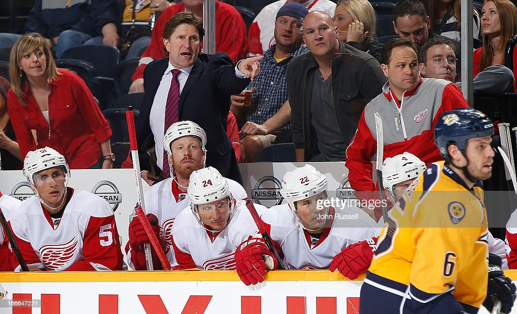 Head coach <a gi-track='captionPersonalityLinkClicked' href=/galleries/search?phrase=Mike+Babcock&family=editorial&specificpeople=226668 ng-click='$event.stopPropagation()'>Mike Babcock</a> of the Detroit Red Wings coaches against the Nashville Predators during an NHL game at the Bridgestone Arena on April 14, 2013 in Nashville, Tennessee.