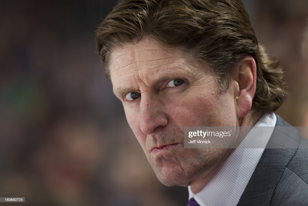 Head coach Mike Babcock of the Detroit Red Wings looks on from the bench against the Vancouver Canucks during their NHL game at Rogers Arena March 16, 2013 in Vancouver, British Columbia, Canada. Detroit won 5-2.