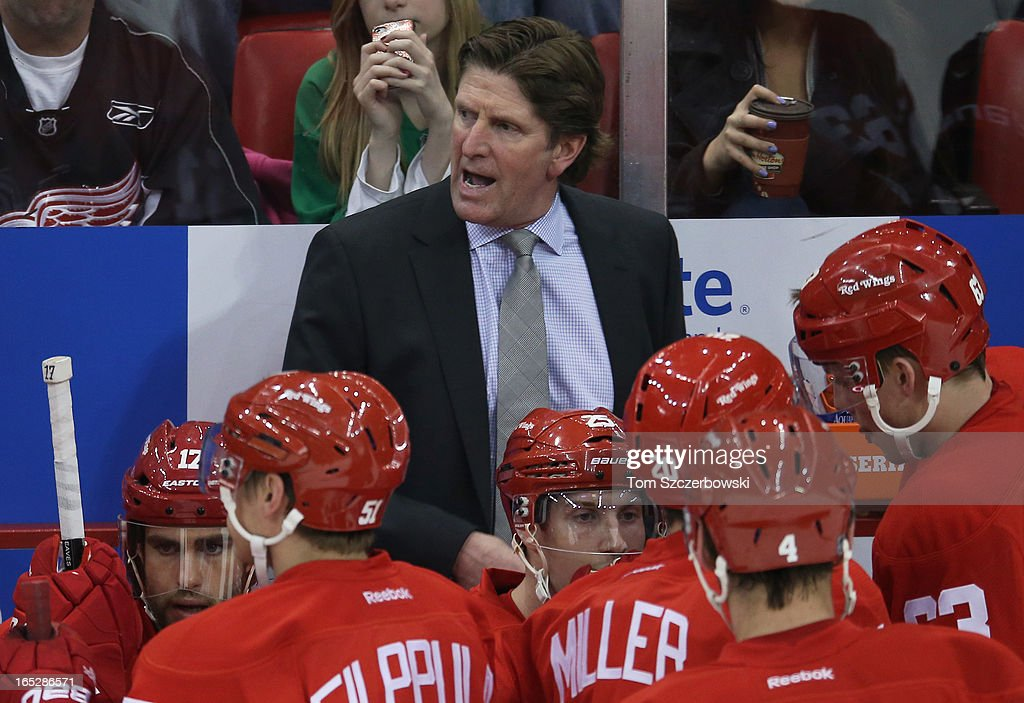 Head coach Mike Babcock of the Detroit Red Wings talks to his players during a timeout during an NHL game against the Chicago Blackhawks at Joe Louis Arena on March 31, 2013 in Detroit, Michigan.