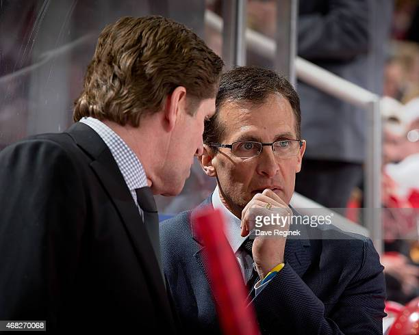 Head coach Mike Babcock of the Detroit Red Wings talks with assistant coach Tony Granato during a NHL game against the Tampa Bay Lightning on March...