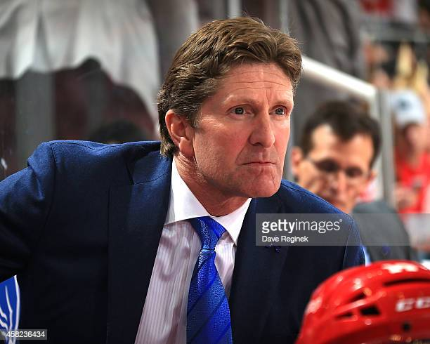 Head coach Mike Babcock of the Detroit Red Wings watches the action from the bench against the Los Angeles Kings during a NHL game on October 31 2014...