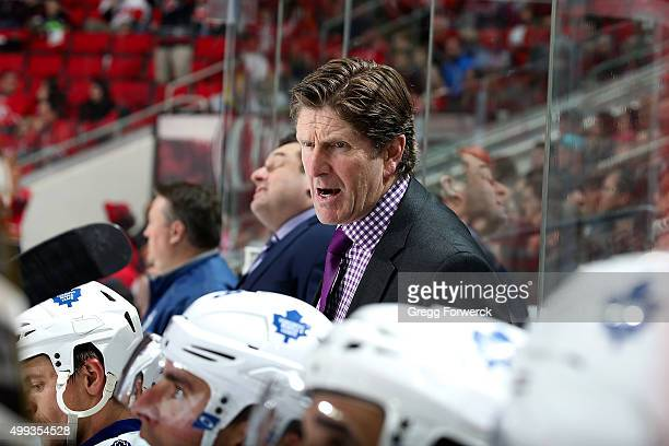Head coach Mike Babcock of the Toronto Maple Leafs coaches his team from the bench area during a NHL game against the Carolina Hurricanes at PNC...