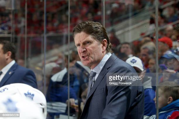 Head coach Mike Babcock of the Toronto Maple Leafs is pictured in the behind the bench coaching during an NHL game against the Carolina Hurricanes on...