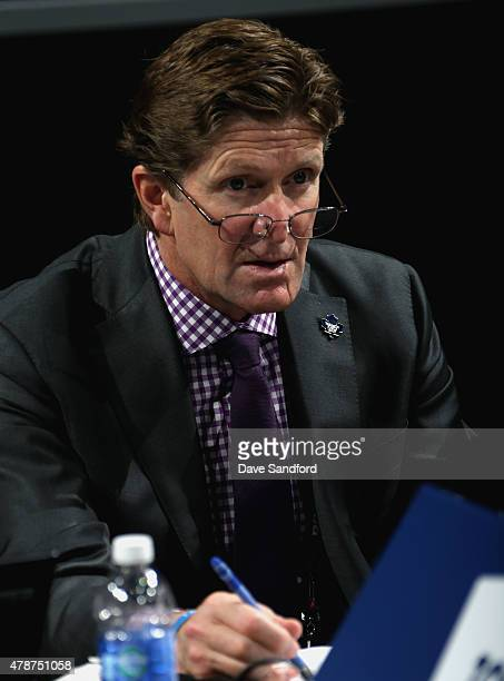 Head Coach Mike Babcock of the Toronto Maple Leafs looks on from the draft table during the 2015 NHL Draft at BBT Center on June 27 2015 in Sunrise...