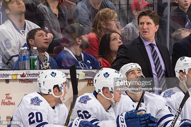 Head coach Mike Babcock of the Toronto Maple Leafs looks on from the bench during an NHL game against the Ottawa Senators at Canadian Tire Centre on...