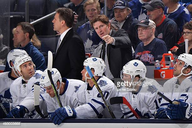 Head Coach Mike Babcock of the Toronto Maple Leafs talks with his players during the first period of a game against the Columbus Blue Jackets on...