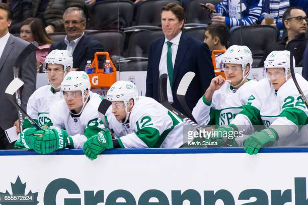 Head coach Mike Babcock watches from the bench during the third period at an NHL game against the Chicago Blackhawks at the Air Canada Centre on...