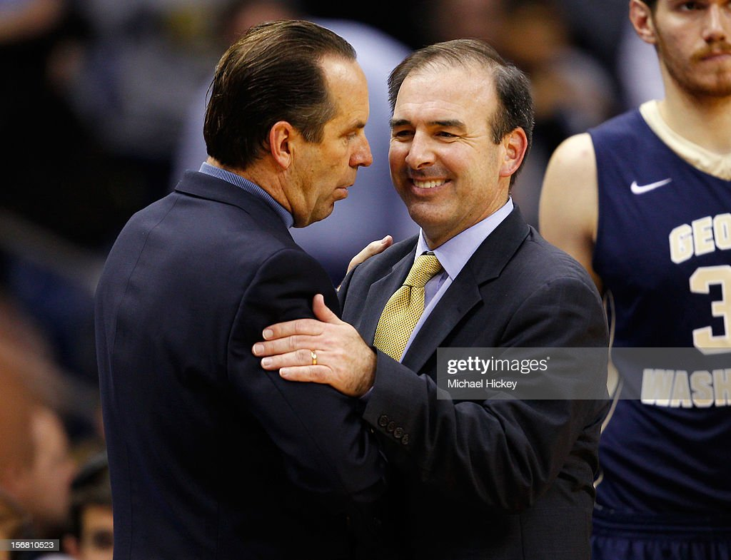 Head coach <a gi-track='captionPersonalityLinkClicked' href=/galleries/search?phrase=Mike+Brey&family=editorial&specificpeople=221188 ng-click='$event.stopPropagation()'>Mike Brey</a> of the Notre Dame Fighting Irish and Head coach Mike Lonergan of the George Washington Colonials talk after the game at Purcel Pavilion on November 21, 2012 in South Bend, Indiana. Notre Dame defeated George Washington 65-48.