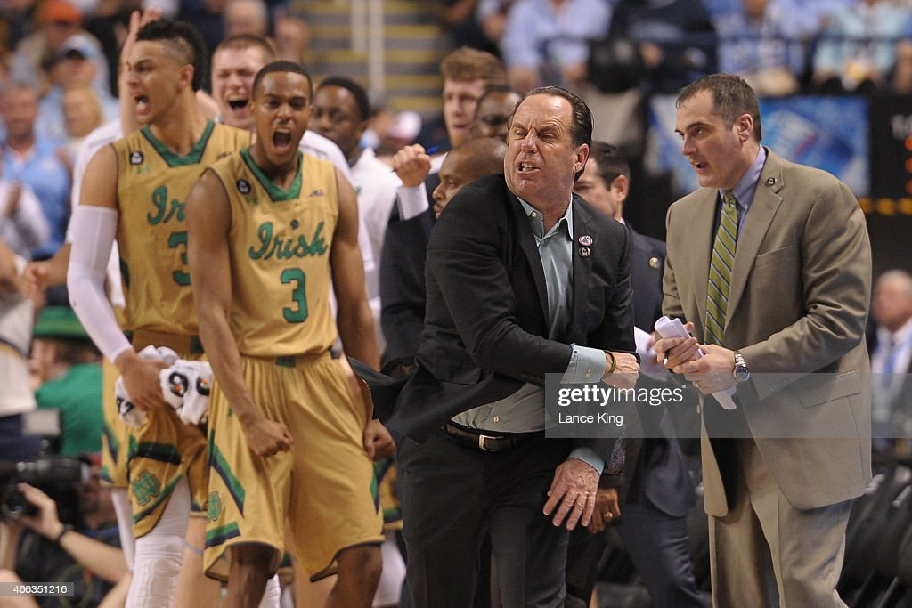 Head Coach <a gi-track='captionPersonalityLinkClicked' href=/galleries/search?phrase=Mike+Brey&family=editorial&specificpeople=221188 ng-click='$event.stopPropagation()'>Mike Brey</a> of the Notre Dame Fighting Irish and his players react against the North Carolina Tar Heels during the finals of the 2015 Men's ACC Tournament at the Greensboro Coliseum on March 14, 2015 in Greensboro, North Carolina.