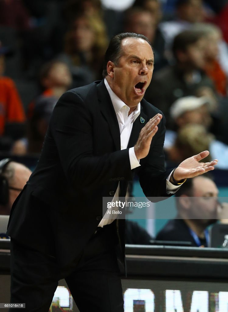 Head coach Mike Brey of the Notre Dame Fighting Irish in action against the Virginia Cavaliers during the Quarterfinals of the ACC Basketball Tournament at the Barclays Center on March 9, 2017 in New York City.