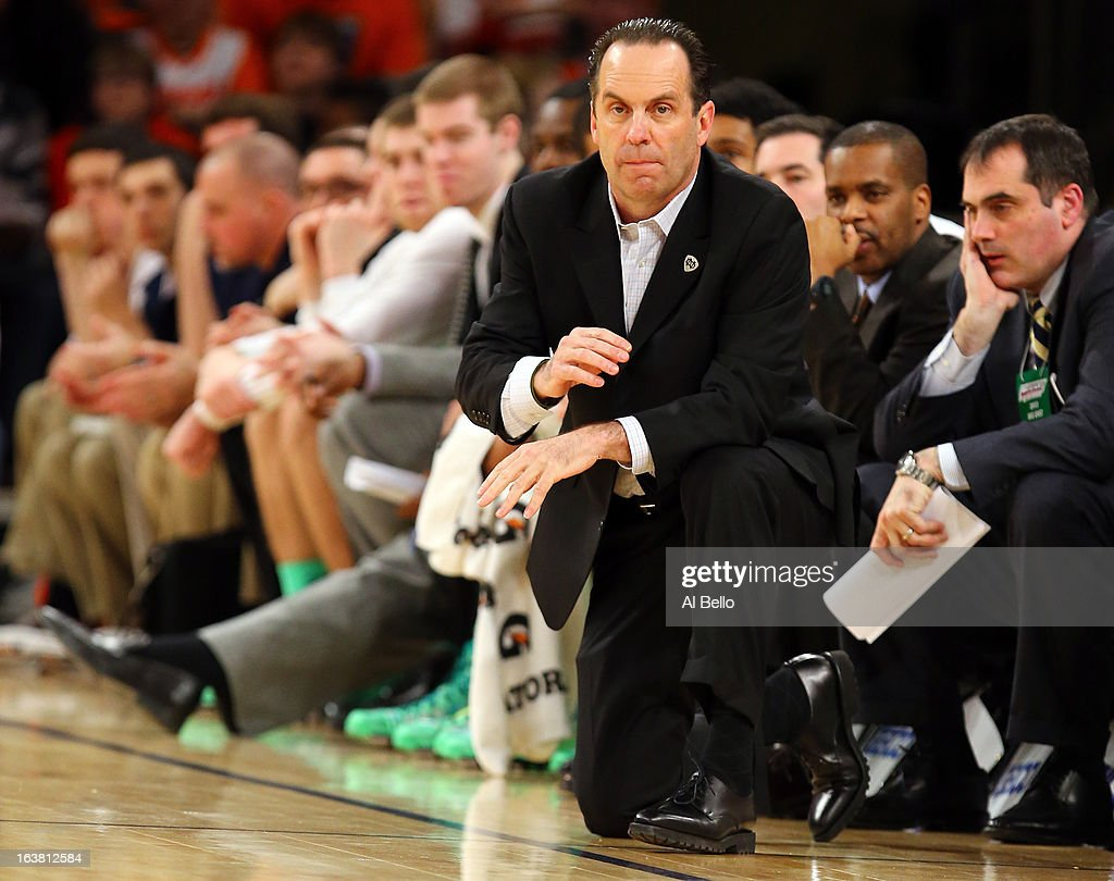 Head coach Mike Brey of the Notre Dame Fighting Irish looks on against the Louisville Cardinals during the semifinals of the Big East Men's Basketball Tournament at Madison Square Garden on March 15, 2013 in New York City.