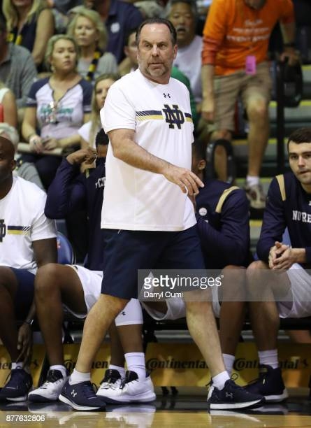 Head coach Mike Brey of the Notre Dame Fighting Irish paces along the sideline during the first half of the game against the Wichita State Shockers...